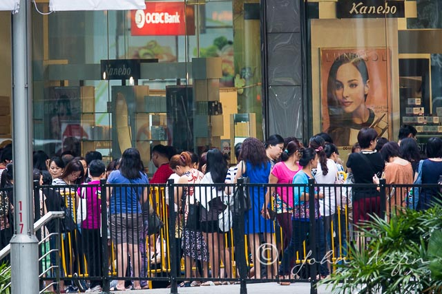 Crowd forming in front of the shopping centre at Orchard Road